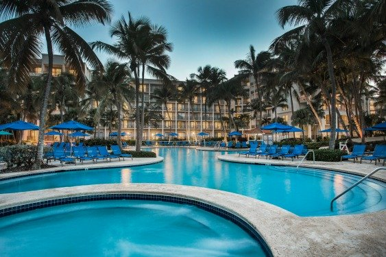 Best husband-wife golf vacation to Puerto Rico includes Relaxing by the pool after a round at the Wyndham Grand Rio Mar Puerto Rico Golf & Beach Resort.